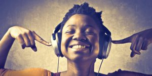 Girl listening to headphones smiling